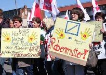 Ansagen für den Eigner der Postbank: es gibt gute Gründe für den Kündigungsschutz. Demonstration in Berlin am 20. April 2015