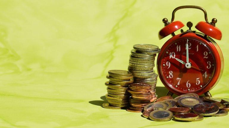 Geld Zeit Uhr Münzen